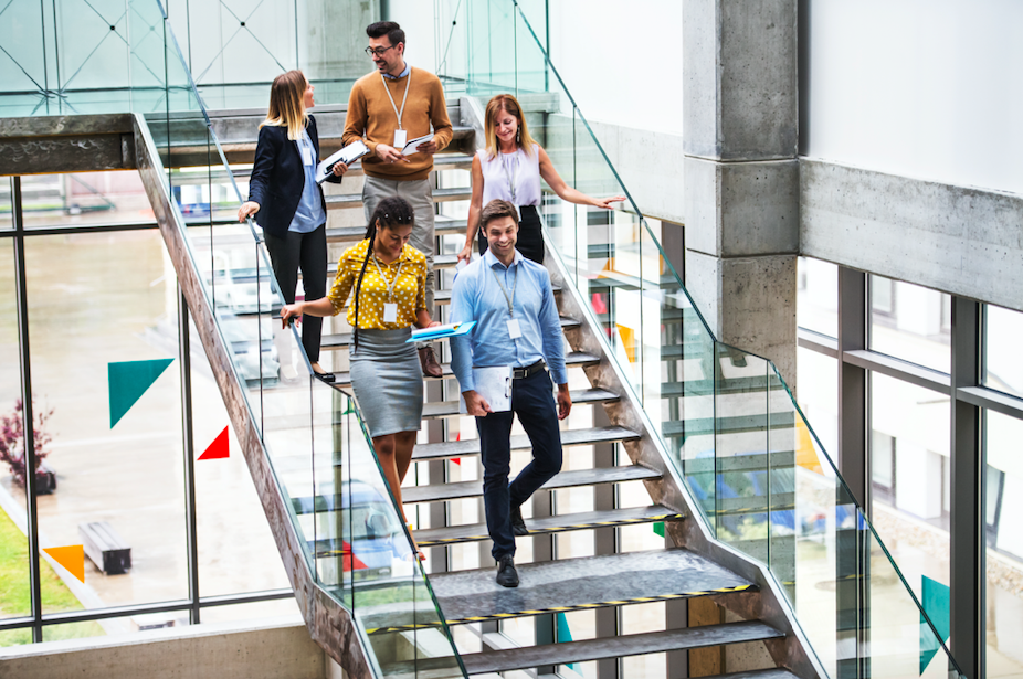 business people going down stair in an office